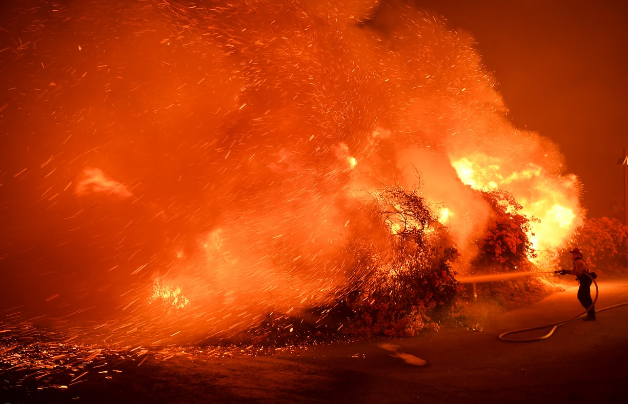 A firefighter battles the blaze in the coastal town of La Conchita Photo: Wally Skalij, LA Times via Getty Images