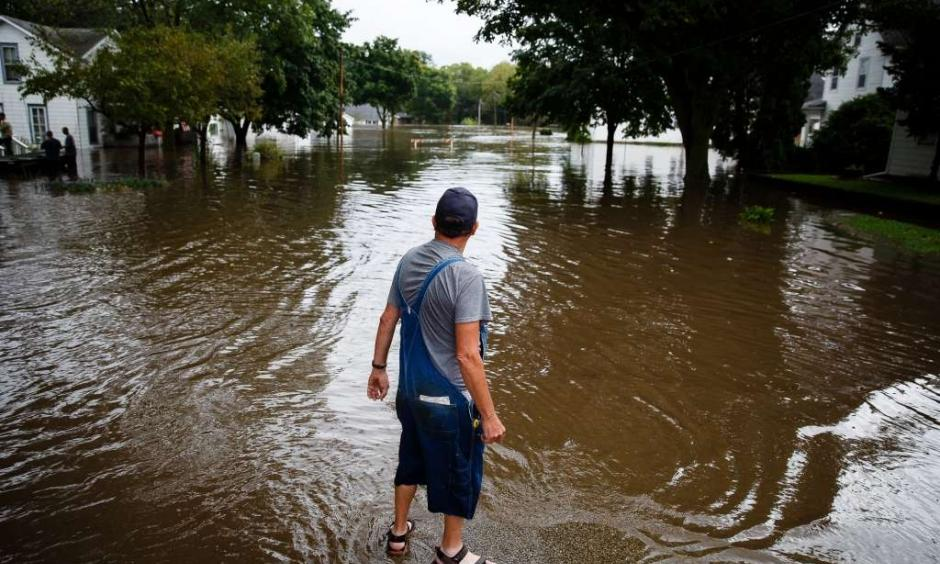 Tom Moffit survey's the flood waters filling his house and street on Friday, Sept. 23, 2016, in Shell Rock, Iowa. Photo: Brian Powers, AP
