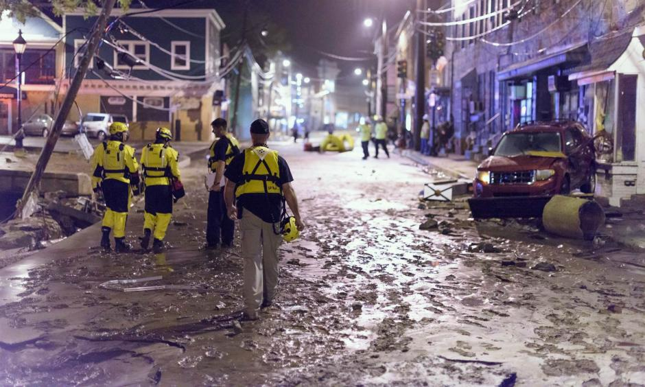 Officials assess damage along Main Street in Old Ellicott City. Photo: NBC News