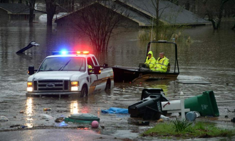 Bossier Parish Sherrif's deputies search for people that may be stranded in the homes in Shreveport, La., on Wednesday, March 9, 2016. Dozens of homes were flooded and scores of residents were evacuated. Photo: Douglas Collier, The Shreveport Times via AP