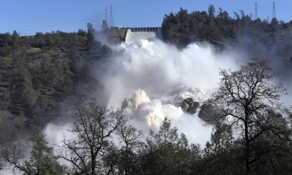 Water is released down the damaged primary spillway in Oroville on Feb. 14. Photo: Michael Short, Bloomberg