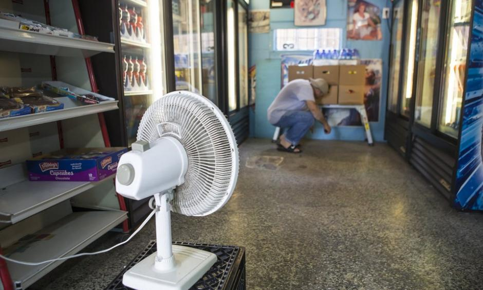 Fadi Abuali, owner of Busy Bee Food Store on Orleans Avenue, uses a small fan to dry out his store in New Orleans on Sunday, August 6, 2017 following an unexpectedly heavy rain on Saturday. He said he stayed at his store till 2 am because he couldn't leave due to the flooded streets. Photo: Chris Granger, NOLA.com | The Times-Picayune
