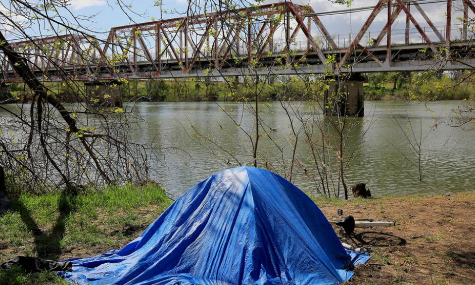 A homeless campsite along the American River in Sacramento in March. Photo: Jim Wilson, The New York Times