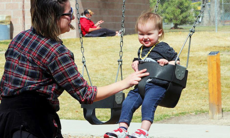 Victoria Westfall of Grand Junction, pushes her son, Isildur Westfall, on the swings at Lincoln Park on a warm afternoon. Photo: Daily Sentinel