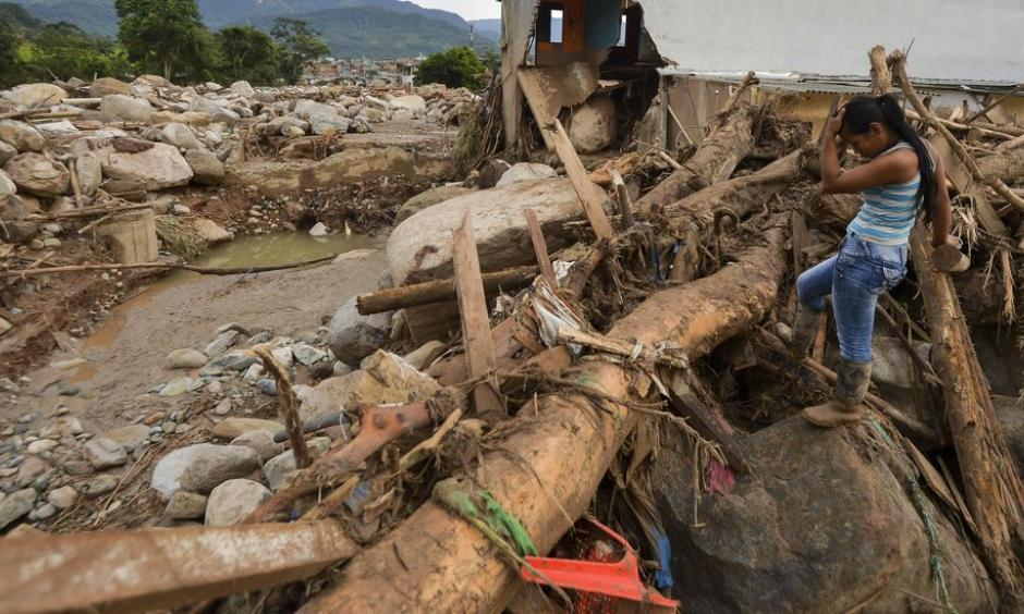 A survivor on Sunday amid the damage caused by a mudslide after heavy rains in Mocoa, Colombia. Photo: Credit Luis Robayo, Agence France-Presse