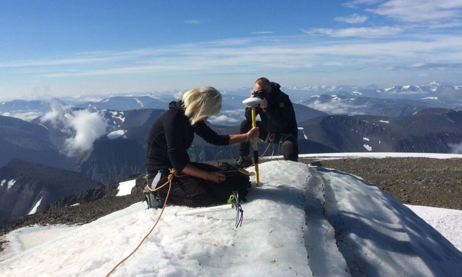Gunhild Rosqvist, a Stockholm University geography professor, making measurements atop the southern tip of Kebnekaise, formerly Sweden's highest peak. Photo: Carl Lundberg, Stockholm University, via Agence France-Presse/Getty Images