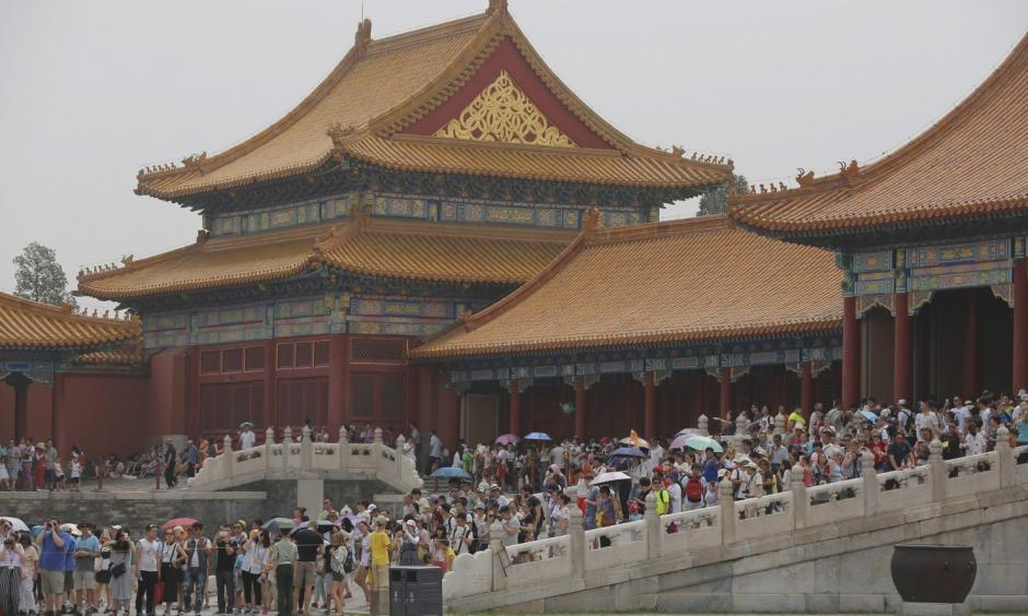 Tourists visit the Forbidden City in Beijing in early July. Photo: Wu Hong/European Pressphoto Agency