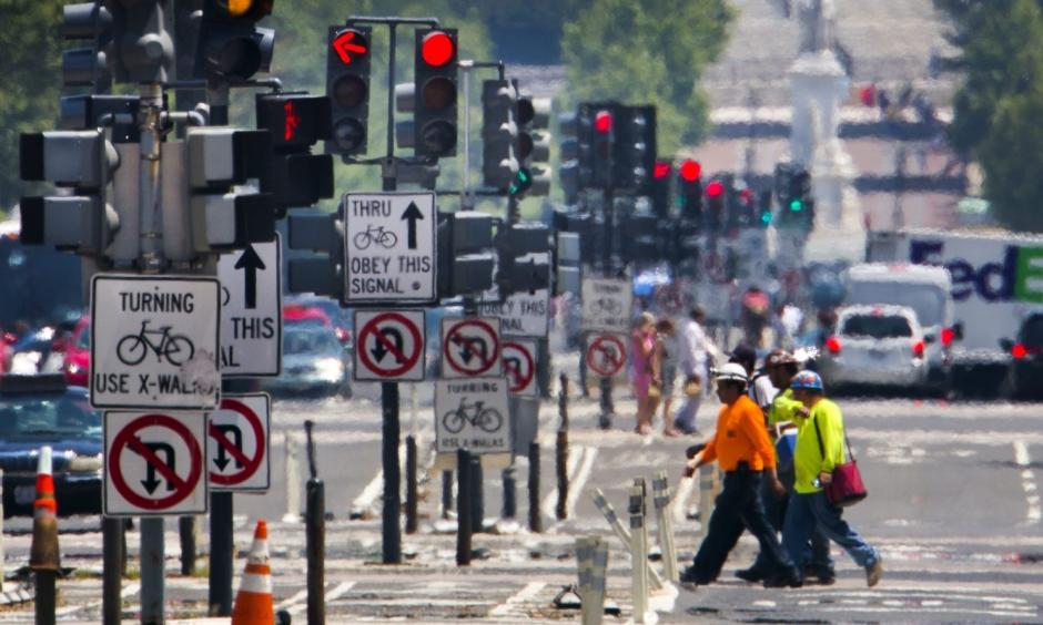 Construction workers cross Pennsylvania Avenue as the temperature reaches 98 degrees Fahrenheit in Washington on Monday. Photo: Jim Lo Scalzo / European Pressphoto Agency