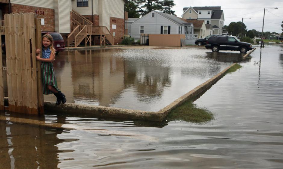 Chloe Riffle, 7, on a flooded street in Norfolk, Va., on Sunday. Photo: Vicki Cronis-Nohe/The Virginian-Pilot, via Associated Press