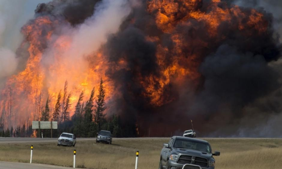 A wildfire burns near Fort McMurray, Alberta, Canada, on May 7. Photo: Premier of Alberta/flickr