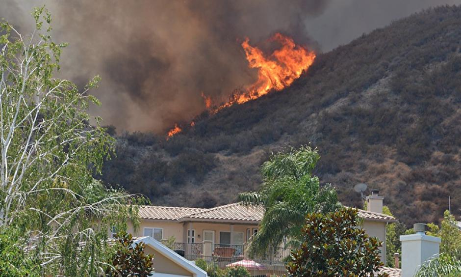 The Sage Fire burns Saturday, July 9, 2016, near a home on Morning Mist Drive in Santa Clarita. Photo: Rick McClure / Special to the Los Angeles Daily News