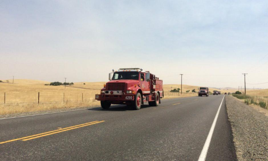 Trucks head toward the Detwiler Fire in Mariposa County on July 19, 2017. Photo: Bob Moffit, Capital Public Radio