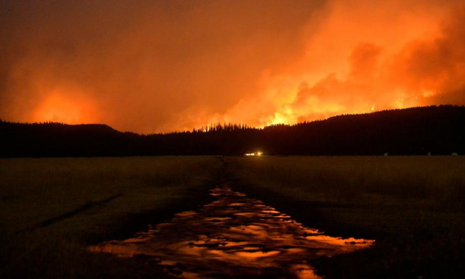 A wildfire burned in the Lolo National Forest near Salmon Lake in Montana in August. Credit Rion Sanders/The Great Falls Tribune, via Associated Press