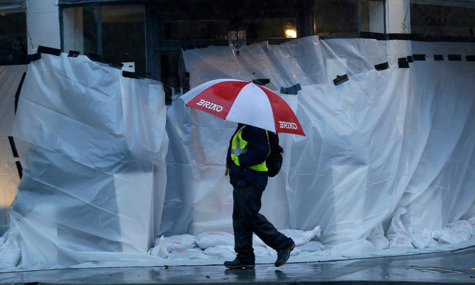 Storefronts were covered against a deluge in San Anselmo, in Marin County. Photo: Jeff Chiu, Associated Press