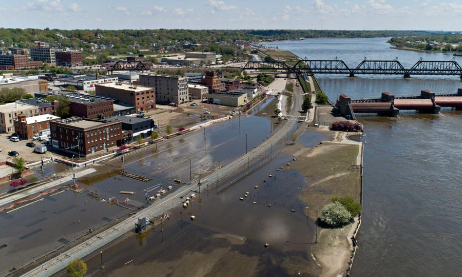 The Mississippi River, which gushed into downtown Davenport, Iowa, at record levels two weeks ago, has finally retreated toward its banks. Credit: Daniel Acker for The New York Times