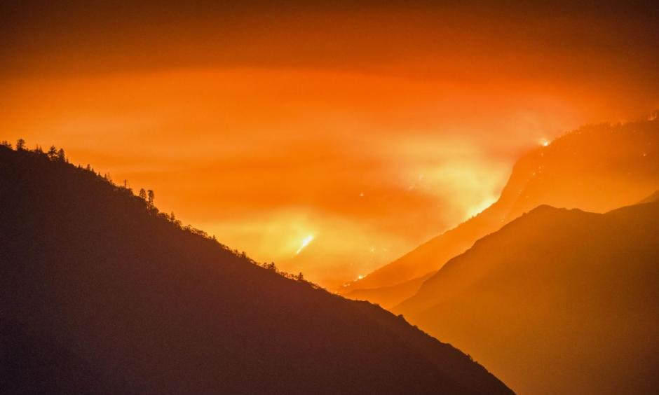 Known as the Rough Fire, a wildfire raged through national forests and parks in California from late July through October, burning about 152,000 acres and sending plumes of smoke over Central Valley cities such as Fresno, 35 miles away. Photo: Stuart Palley, Zuma, Corbis