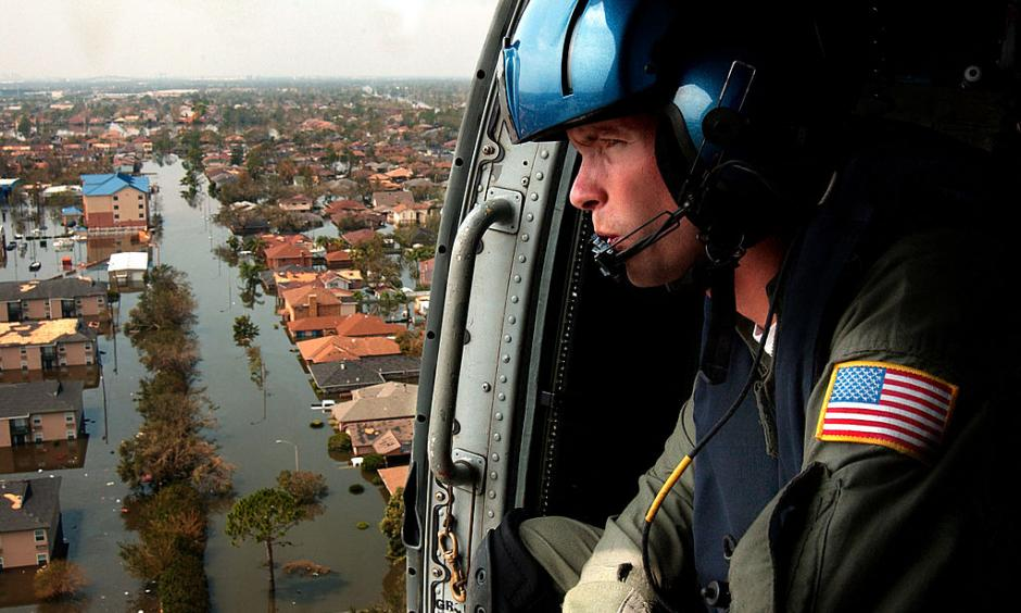 A U.S. Coast Guardsman searches for survivors in New Orleans in the Katrina aftermath. Photo: Wikipedia