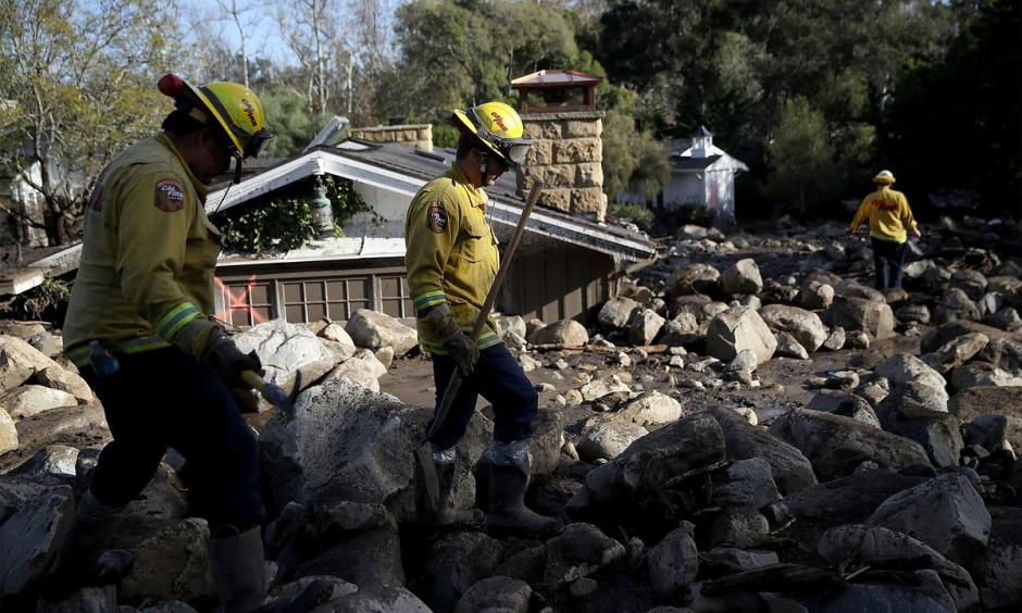 Firefighters search for people trapped in mudslide debris in Montecito, California in 2018.