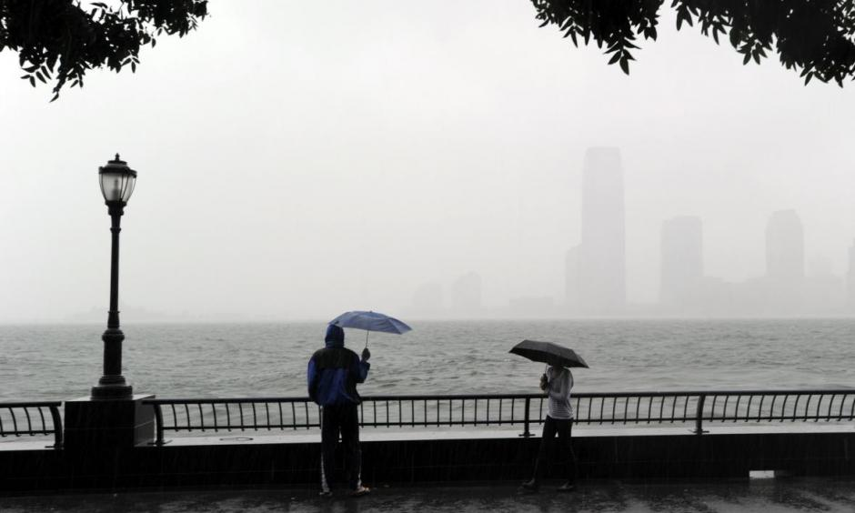 A couple looks at the view of New Jersey from Battery Park in Lower Manhattan on Aug. 28, 2011, as Hurricane Irene hit the region with rain and high winds. Coastal flooding from this week's blizzard may match or exceed Irene's levels. Photo: Stan Honda, AFP/Getty Images