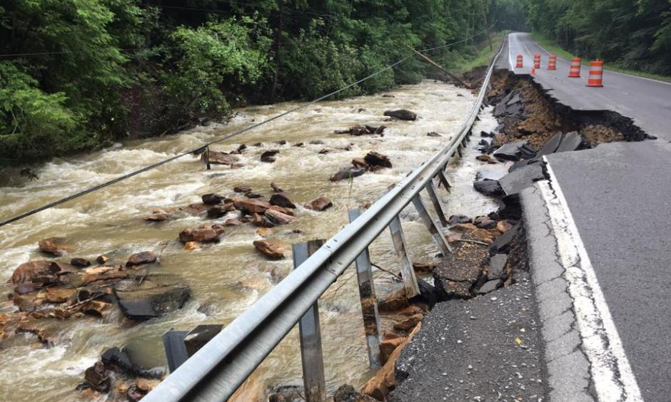 A powerline toppled into Brackens Creek next to a washout of WV Route 60 between Lookout and Hilton VIllage. Photo: Rebecca Lindsey