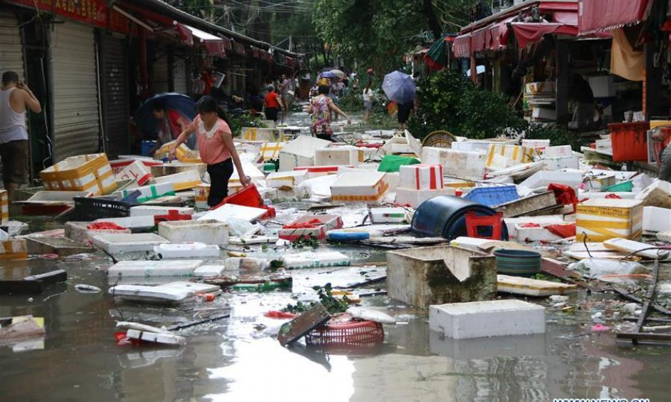 Boxes scatter on a flooded road in typhoon-hit Xiamen City, southeast China's Fujian Province, Sept. 15, 2016. Typhoon Meranti made landfall in Xiamen in the early morning on Thursday, with gales up to 48 meters per second. Photo: Zeng Demeng, Xinhua