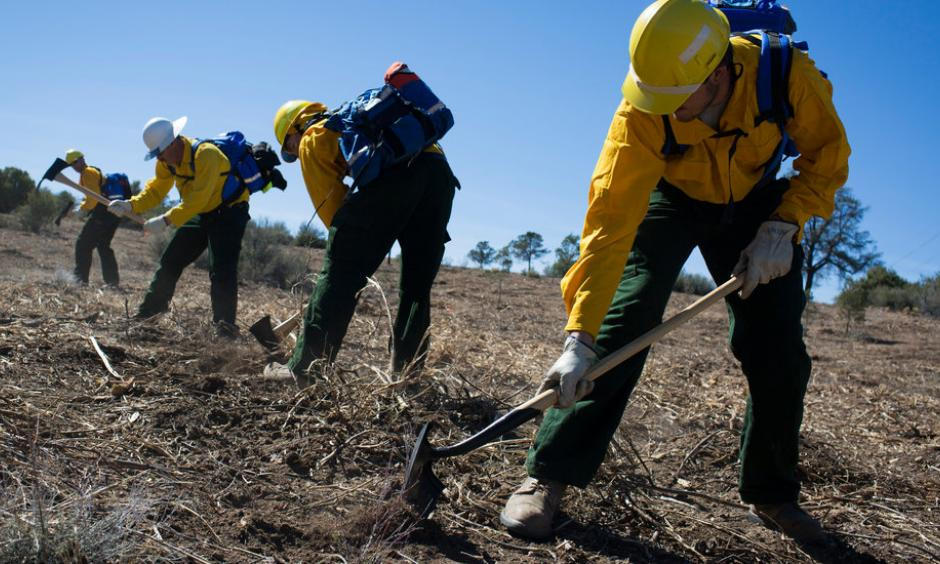Trainees learned to dig a fire line at the Arizona Wildfire and Incident Management Academy at Embry-Riddle Aeronautical University in Prescott. The federal costs of fighting fires rose to $2 billion last year. Photo: Caitlin O'Hara, The New York Times
