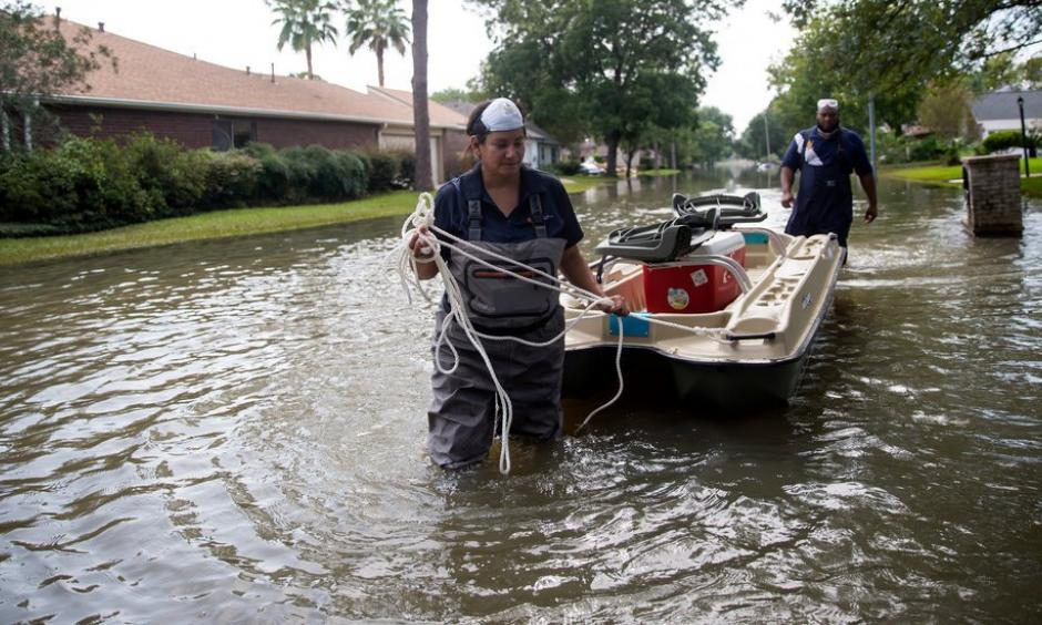 Lisa Montemayor, an environmental investigator with the Houston Health Department, and Jesse Crain III, an environmental assessor with the Environmental Health Service at the Baylor College of Medicine, collecting water samples last week in Houston neighborhoods affected by flooding from Hurricane Harvey. Photo: Eric Thayer, The New York Times