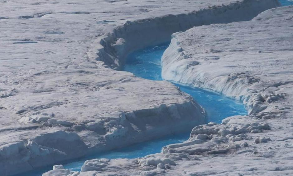 Water courses through Greenland's ice sheet during the summer melt on July 17, 2013. Photo: Joe Raedle, Getty Images