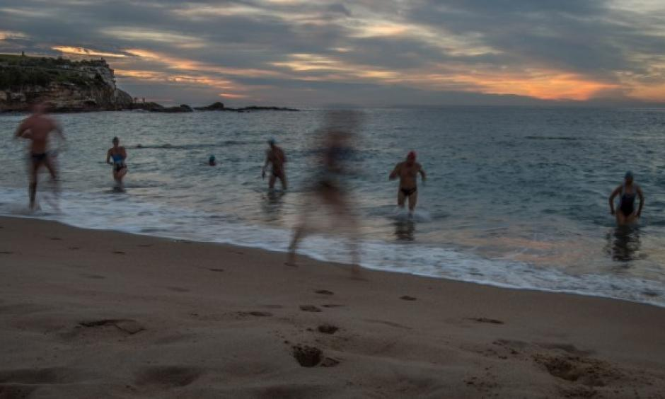 Swimmers enjoy the warm weather at Coogee Beach on Tuesday. Photo: Wolter Peeters