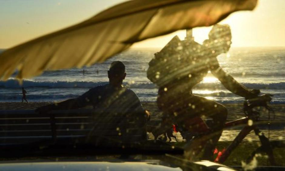 A warm dawn brought plenty of surfers and swimmers out on the Northern Beaches. Photo: Nick Moir