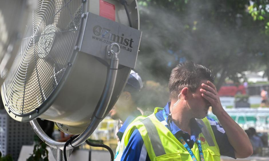 A man cools down in front of a mist fan for relief from the hot weather in Melbourne on Jan. 25, 2019. Photo: Saeed Khan, AFP/Getty Images