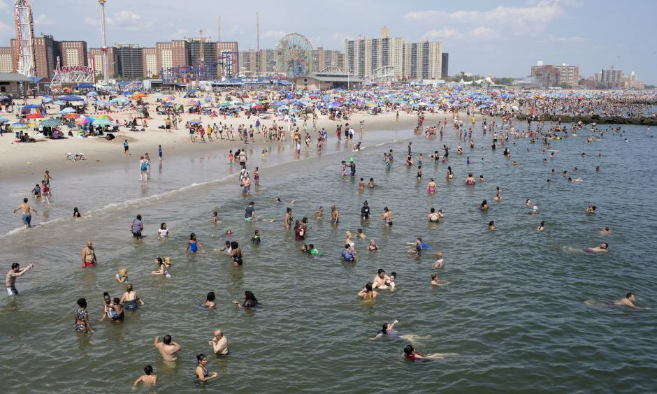 People seek refuge from the searing heat at the beach in Coney Island, New York City. Credit: Andrew Lichtenstein, Corbis via Getty Images