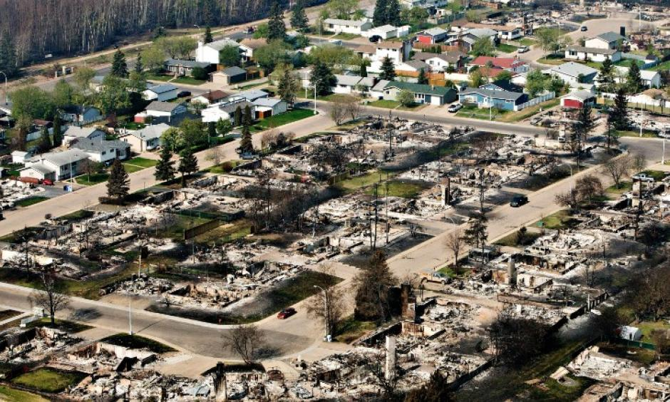 Remains of burned homes are seen in a neighborhood in Fort McMurray, Alberta, on Friday, May 13. Photo: CNN