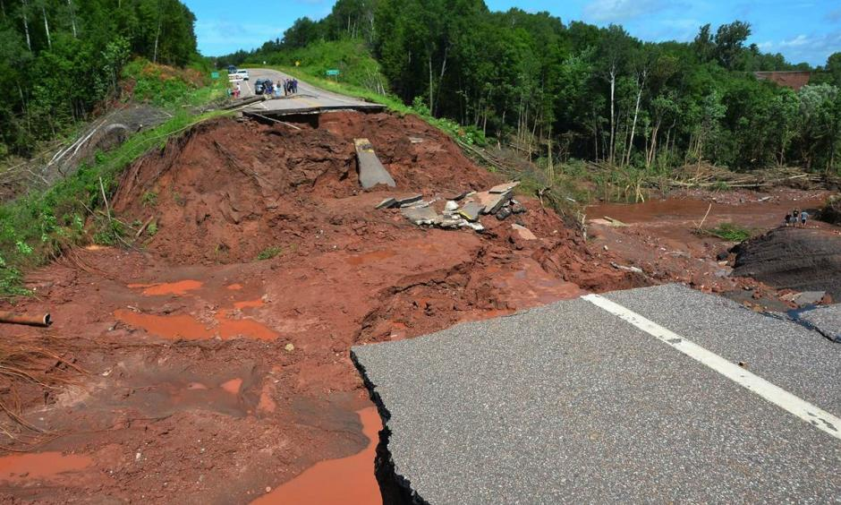 A section of Wisconsin Highway 13 is washed out after heavy rains, south of Highbridge in Ashland, Wis., on July 12. Photo: Jeff Peters / AP