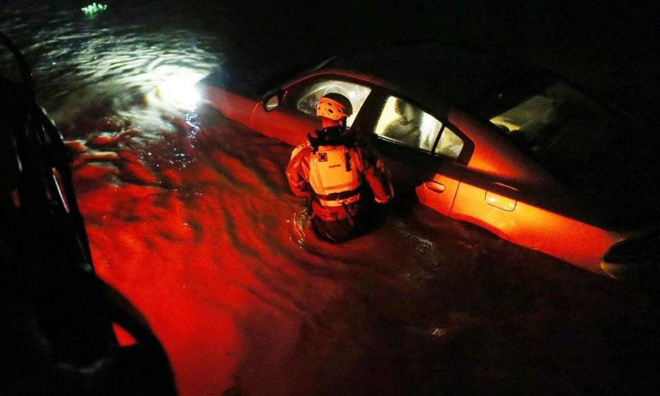 A rescue team inspects flooded areas after Hurricane Irma stuck Fajardo, Puerto Rico on Wednesday. Photo: Jose Jimenez / Getty Images