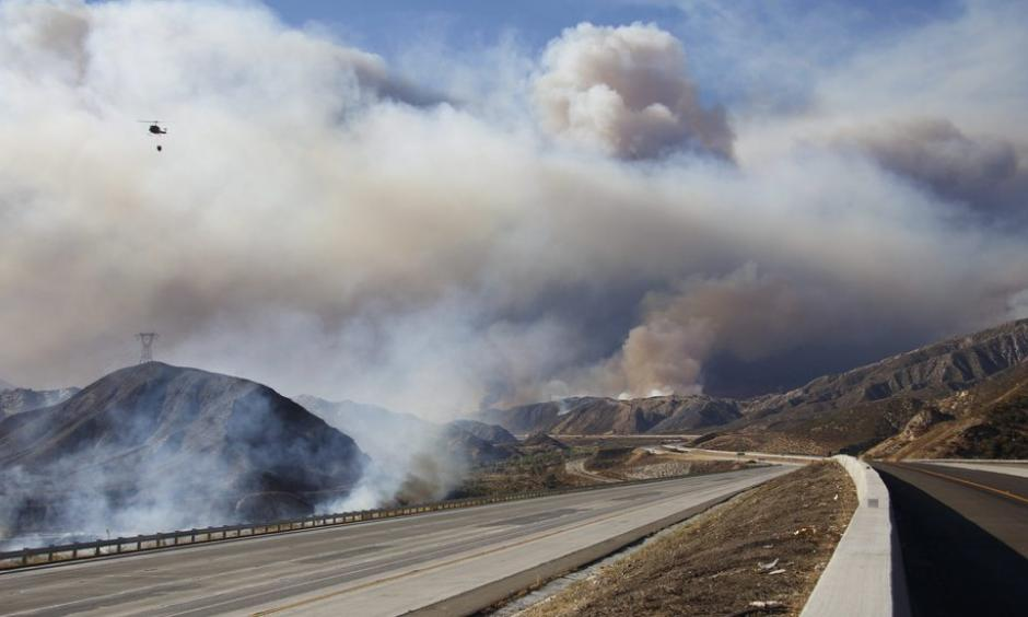 As of Tuesday night, more than 80,000 people had to evacuate because of the fire. Photo: Reuters and KESQ via Associated Press