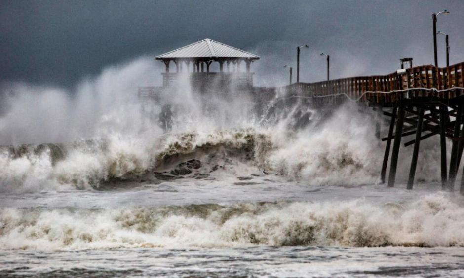 Waves crash around Oceanana Pier in Atlantic Beach, North Carolina, as the outer bands of Hurricane Florence begin to affect the coast on Thursday, September 13. Credit: CNN
