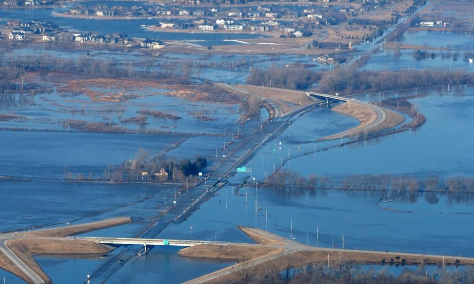 Rain, warm temperatures and snowmelt across the Midwest have caused floods that led to hundreds of evacuations and at least two deaths. Photo: Kent Sievers, Omaha World-Herald, via Associated Press