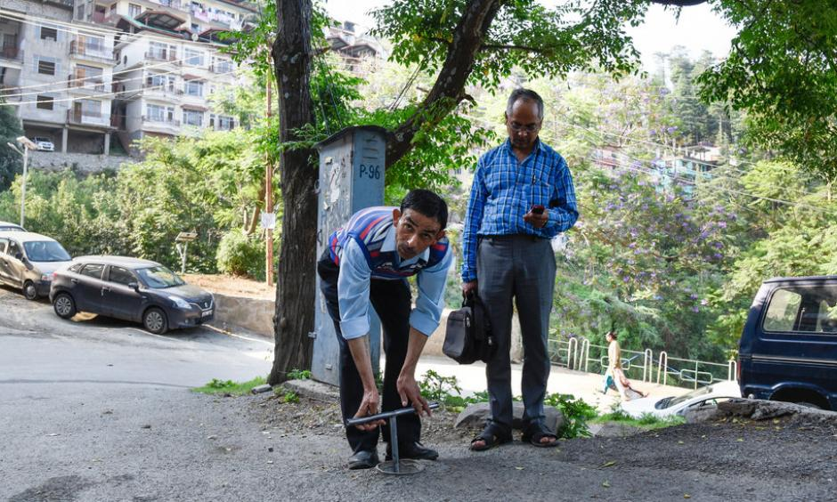 "When the Indian resort town of Shimla ran severely low on water last month, ""key men"" like Inder Singh — who open and close the valves that supply water to each neighborhood — felt the people's wrath. ""I would be mobbed by dozens as I was trying to leave my home for work,"" he said. Photo: Saumya Khandelwal, The New York Times"