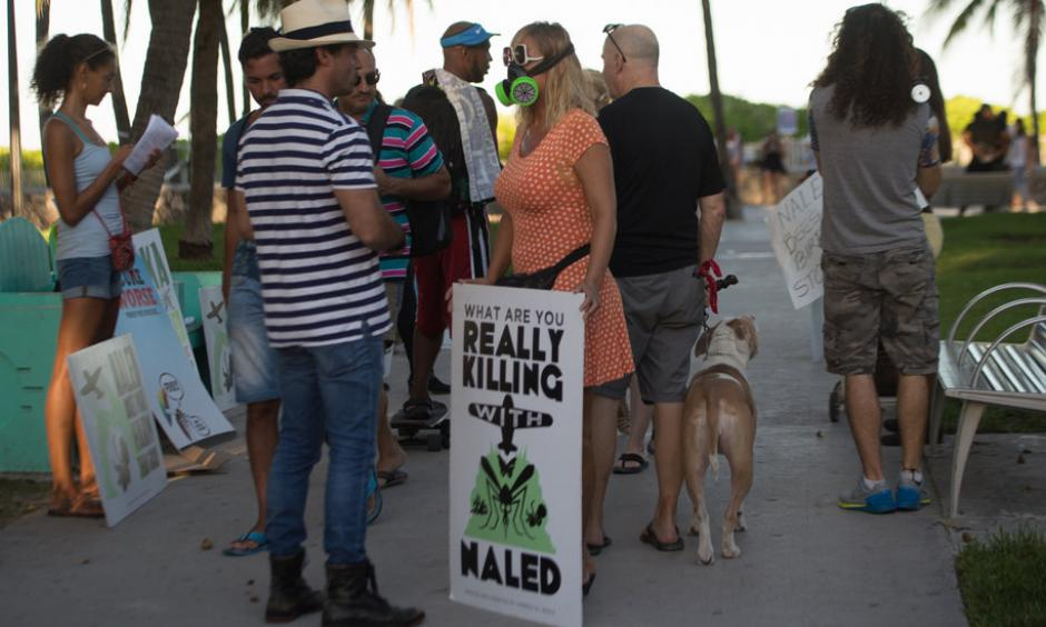 Demonstrators and Miami-Dade County residents during a protest in Miami Beach on Friday against the spraying of the pesticide naled. Photo: Max Reed for The New York Times