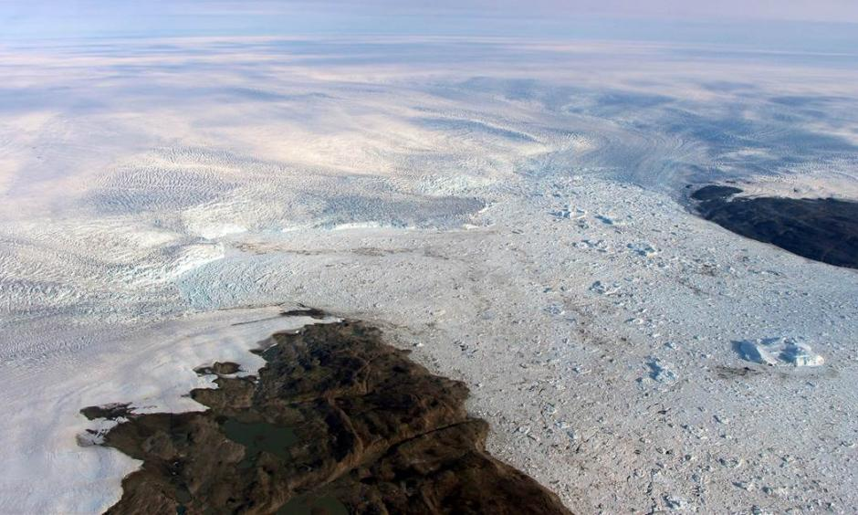 Patches of bare land are seen at the Jakobshavn glacier in Greenland in 2016, but the glacier ice has started to grow again, according to a study released on March 25, 2019. Study authors and outside scientists think this is temporary. Photo: NASA via AP