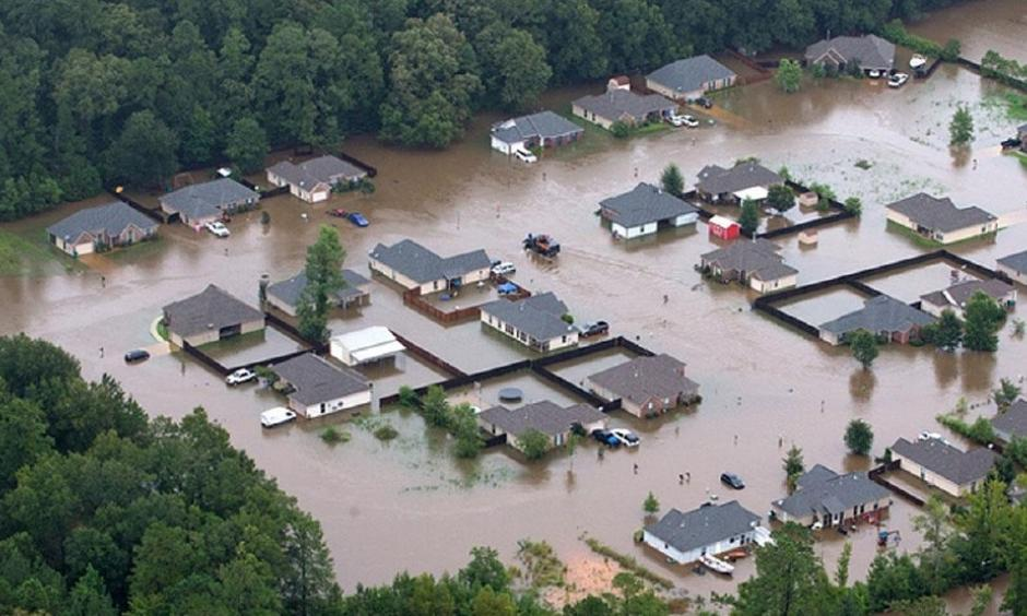 This aerial photo shows flooded homes along the Tangipahoa River near Amite, La., Saturday, Aug. 13, 2016. Photo: Ted Jackson / NOLA