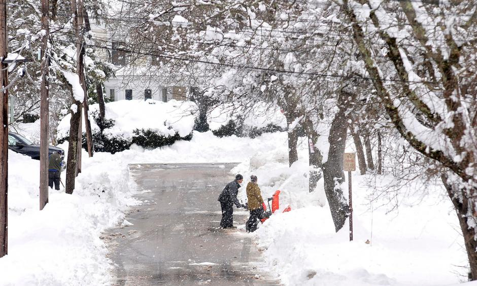 Neighbors dig out a driveway on Rockhill Street in Foxboro, Massachusetts, Monday, March 4, 2019, after the area received well over a foot of snow in an overnight storm. Photo: Mark Stockwell, AP