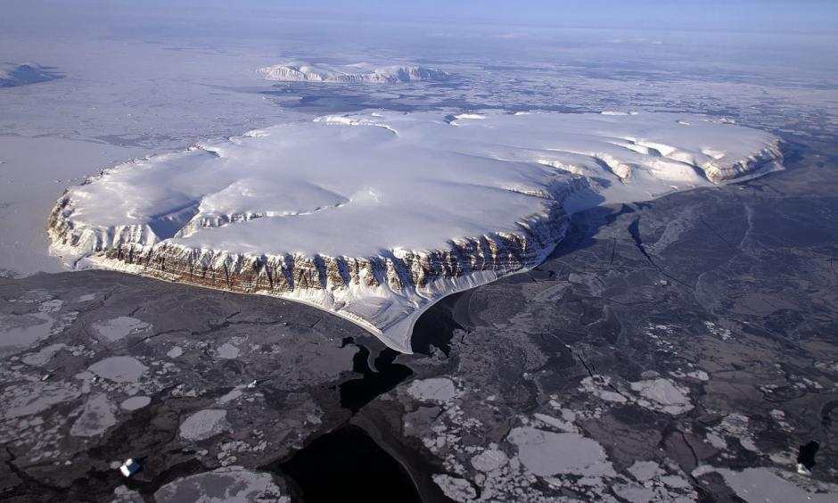 Saunders Island and Wolstenholme Fjord with Kap Atholl in the background are seen in an image taken during an Operation IceBridge survey flight of Greenland in April 2013. Photo: Michael Studinger, NASA/Reuters