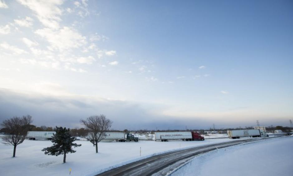 Trucks sit stranded on a closed New York state thruway in the town of Cheektowaga near Buffalo. Photo:Lindsay DeDario, Reuters