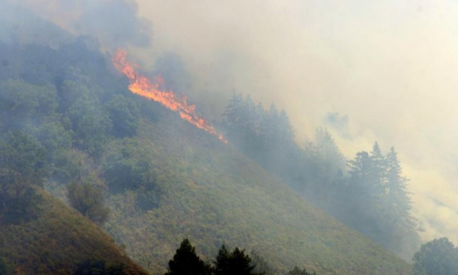 Flames from the Soberanes Fire run down Bixby Mountain near Palo Colorado Canyon on the northern Big Sur Coast on Monday July 25, 2016. Photo: David Royal - Monterey Herald