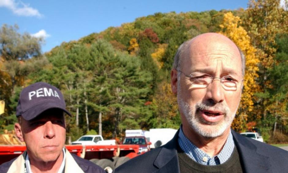 Gov. Tom Wolf speaks to the media in Warrensville Sunday after being briefed about the Sunoco pipeline break and flash flood damage in Lycoming County. At left is Richard D. Flinn, director of the Pennsylvania Emergency Management Agency. Photo: John Beauge