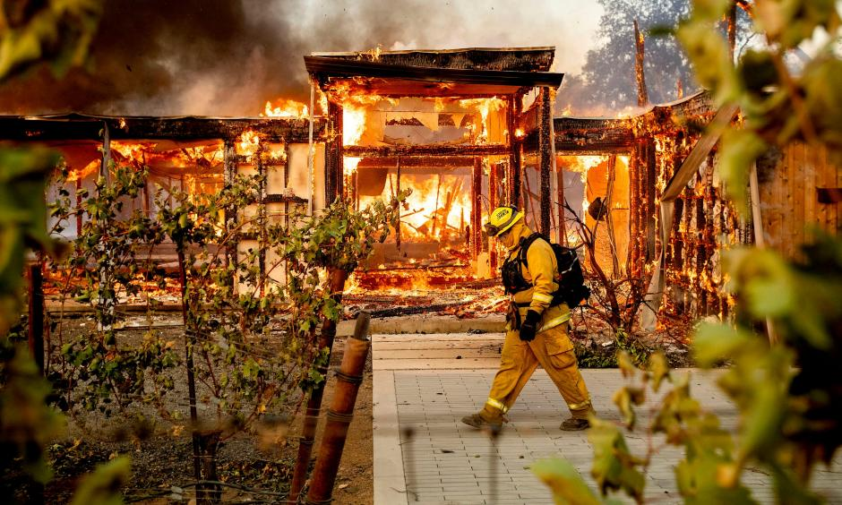 Firefighters try to save a home on Tigertail Road from the Getty fire, Oct. 28, 2019, in Los Angeles. Credit: USA Today