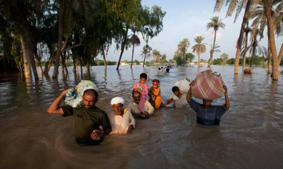 A family leaves flooded Baseera, Pakistan, this week. Photo: Adrees Latif, Reuters