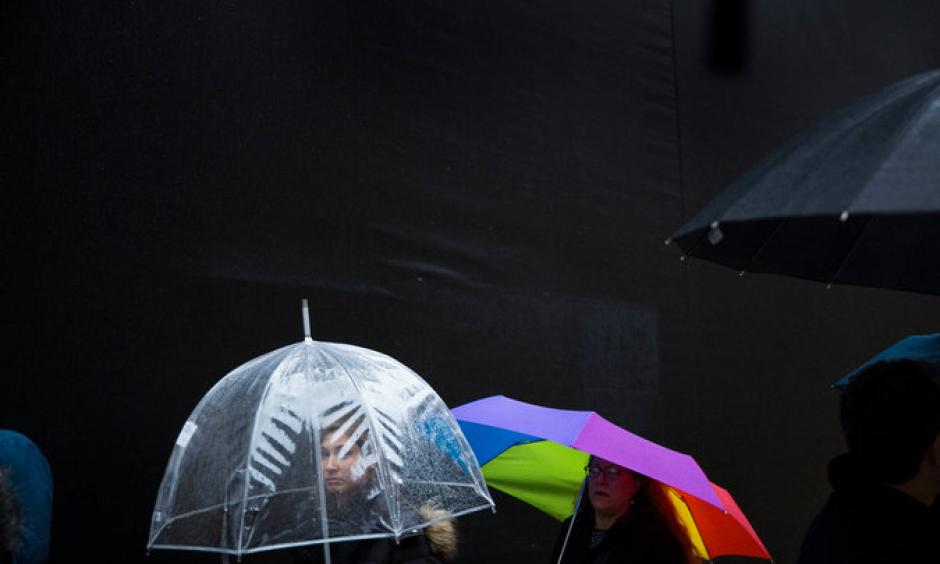 Tuesday was a warm and wet day in Manhattan. Image: Damon Winter, The New York Times